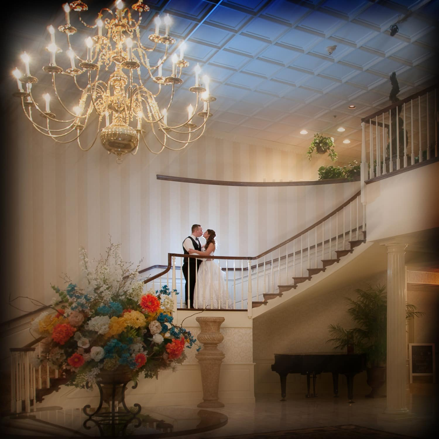 man and wife dancing with chandelier