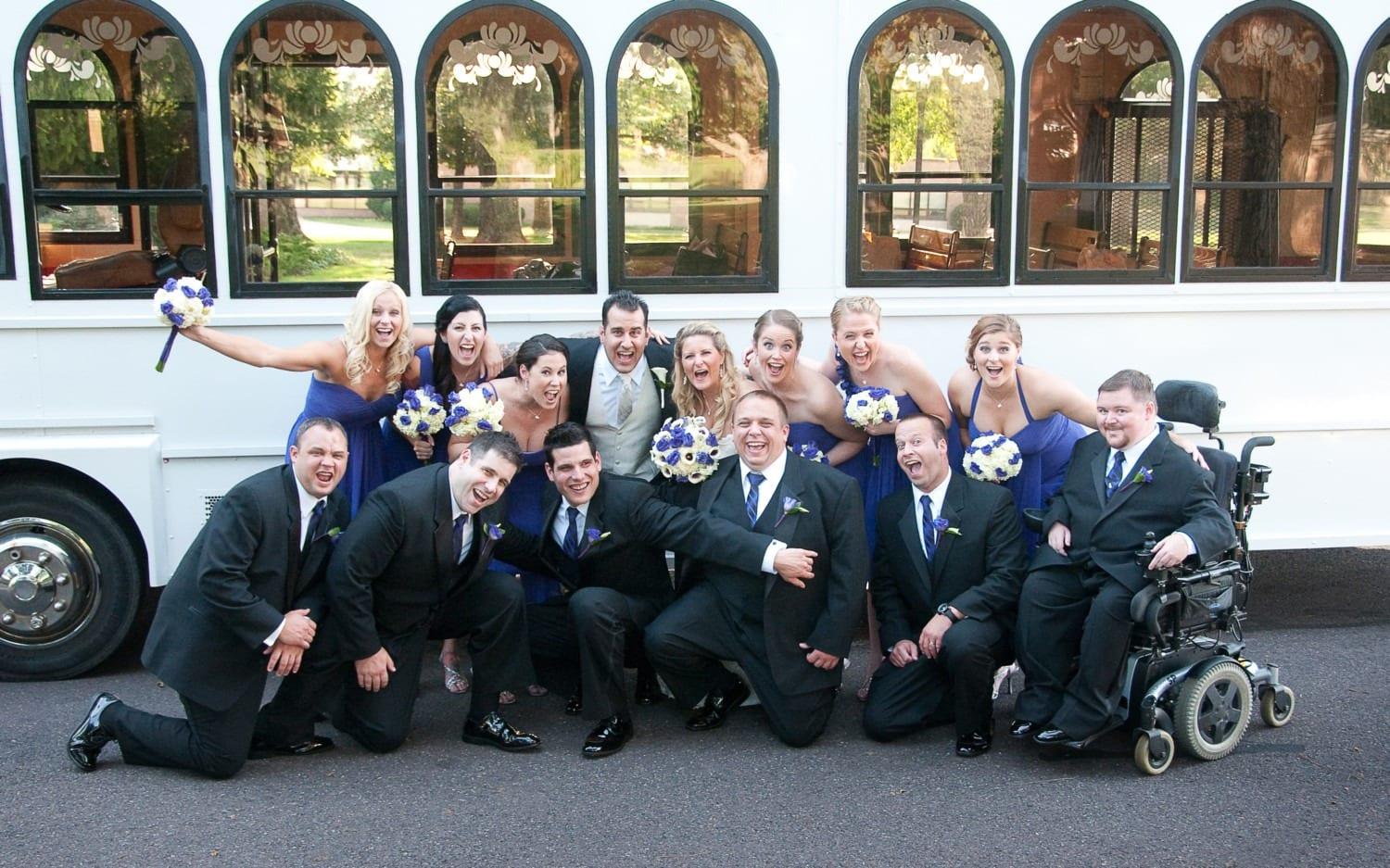 large group wedding photography in front of trolley