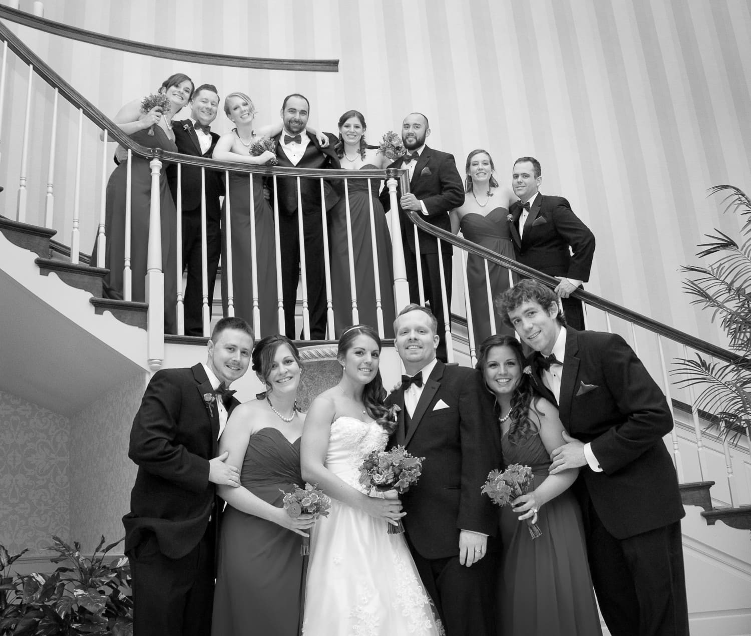 large group wedding portrait by stairs