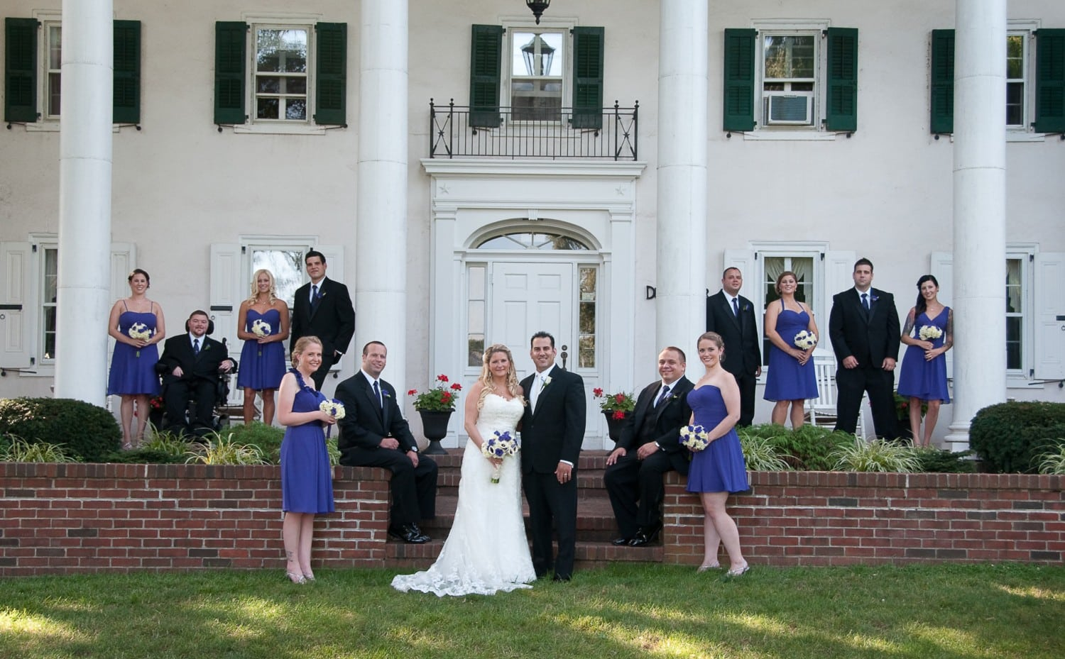 large group wedding photography in front of colonial home