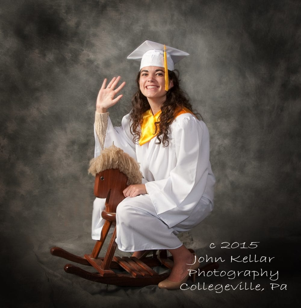 cap and gown graduation portrait