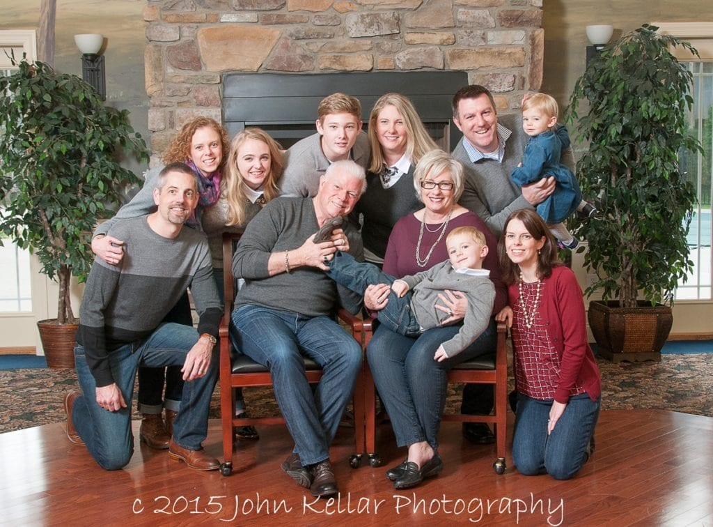 large group family portrait with prop