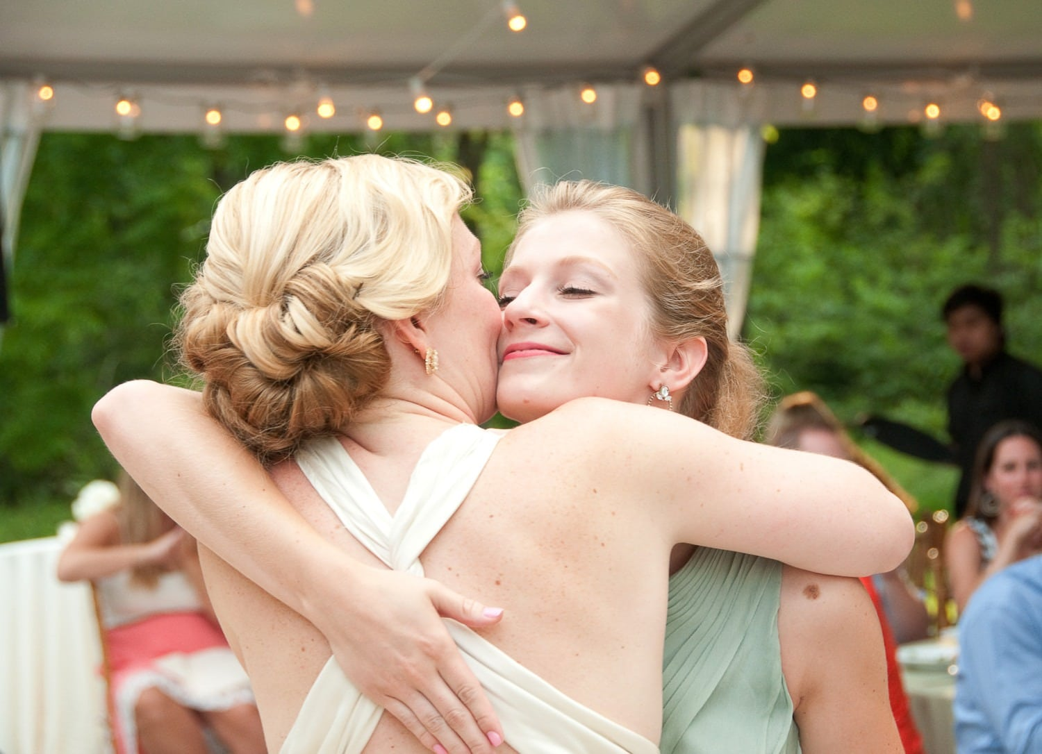 friends hugging at wedding