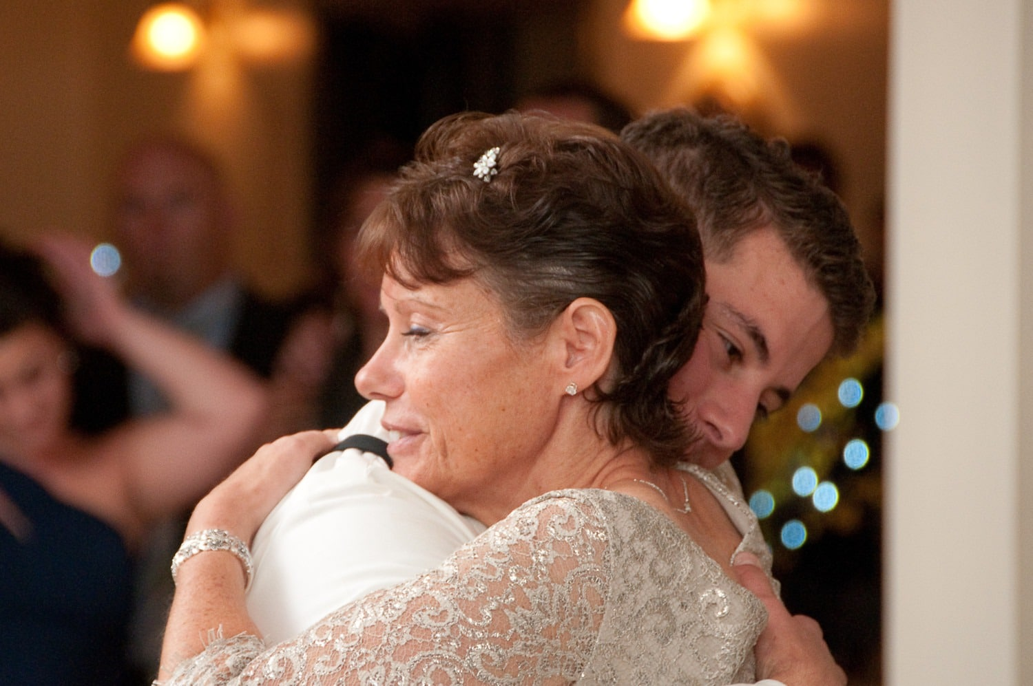 mom and groom hugging on dance floor