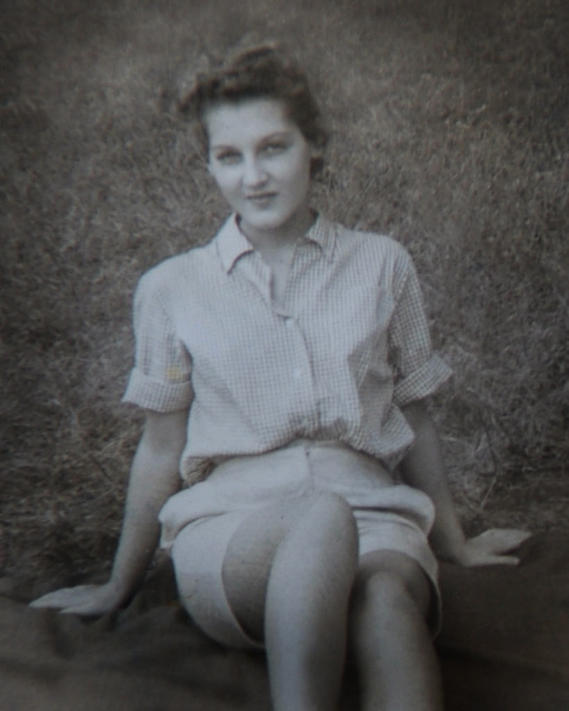 photo restoration woman on the grass