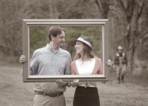 man and women with picture frame